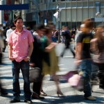 man-standing-on-busy-street-pop_11803